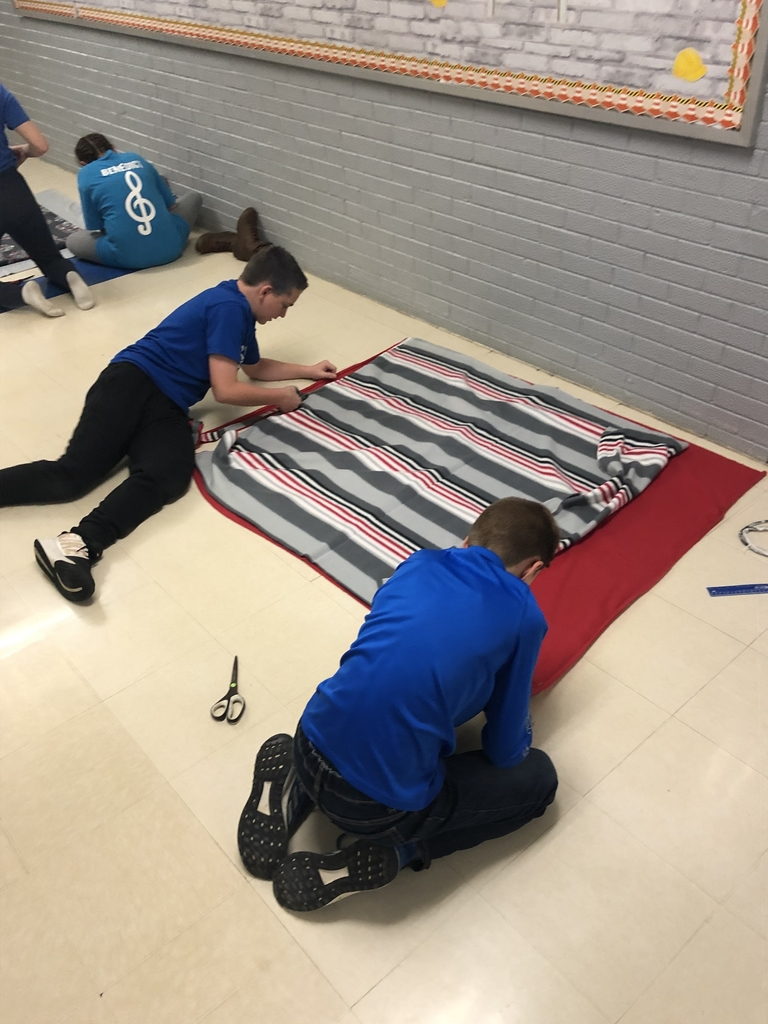 Students working on blankets